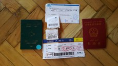 ھىدايەتۇللاھ گۆكتۈرك ئەپەندىنىڭ ئايروپىلانغا چىقىش كارتىسى، پاسپورتى، ۋە توي خېتى. 2016-يىلى 24-ئىيۇن، ئۈرۈمچى.