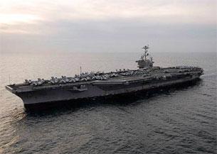 2009 - Yili 11 - mart küni, amérikining ténch okyan qisimining USS John C. Stennis  Namliq awia matkisi koriyining busan portigha kirmekte.