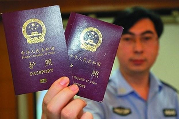 خىتاينىڭ يېڭىدىن لايىھەلەنگەن پاسپورتى تارقىتىلماقتا