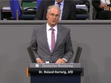 «Германийә үчүн таллаш» партийәсиниң германийә парламенттики әзаси доктор роланд хардвиг(Roland Hartwig) хитай һөкүмитини ақлап соз қилмақта. 2020-Йили 9-сентәбир, германийә.